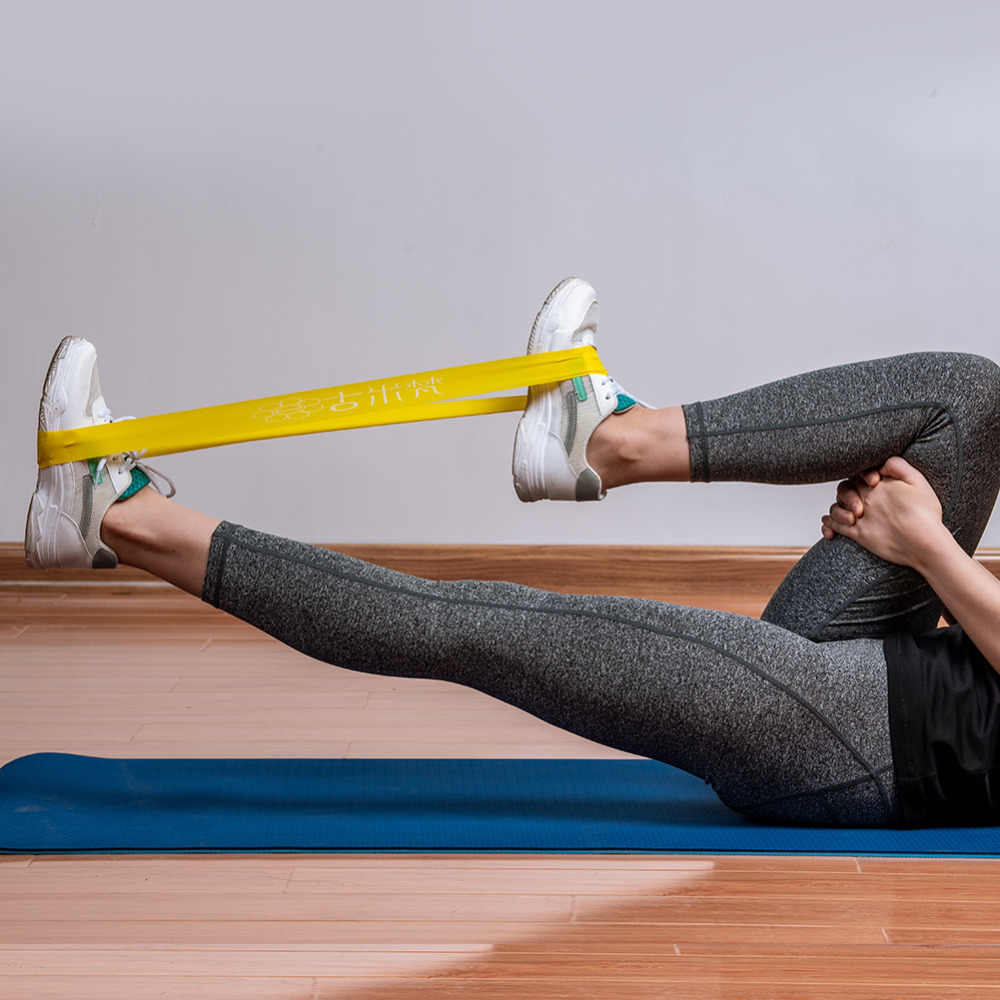 Упражнения с фитнес резинкой для пресса